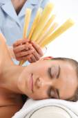 Relax in the spa - ear candling — Stock Photo