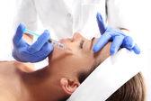 Drooping eyelid, injection of botox — Stock Photo