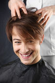 Man at the hairdresser — Stock Photo