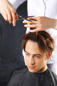 Trendy hairstyle for men, the man at the hairdresser — Stock Photo