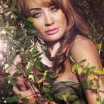 Beautiful woman in autumn scenery — Stock Photo #55681919