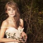 Beautiful woman in autumn scenery — Stock Photo #55682137
