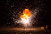 Realistic fiery explosion busting over a black background — Stock Photo