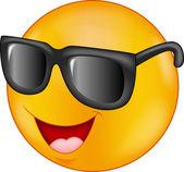 Smiling emoticon cartoon wearing sunglasses — Stock Vector