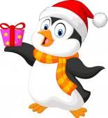 Cute penguin cartoon holding present — Stock Vector