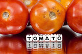 Red tomatoes with text — Stock Photo