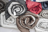 Rolled quilts — Stock Photo