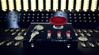 Red button marked Launch  on a control console — Stock Video