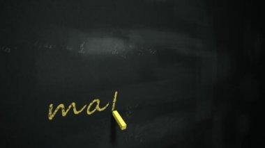 Drawing word mathematics on chalkboard. — Stock Video