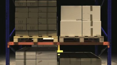 Forklift Truck Placing Stack Of Cardboard Boxes — Stock Video