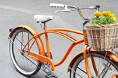 Orange bicycle with flower basket. — Stock Photo