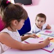 Two children studying at home — Stock Photo #62002147