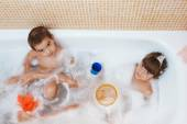 Children playing in the bathroom — Stock Photo