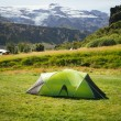 Tent front of the glacier — Stock Photo #67600203