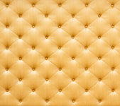 Golden color sofa cloth texture — Stock Photo