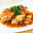 Deep fried grouper fish spicy sweet and sour sauce — Stock Photo #59179131