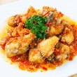Deep fried grouper fish spicy sweet and sour sauce — Stock Photo #59182951