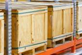 Cargo box on steel shelf system in warehouse — Stock Photo