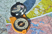 Compass on the maps. — Stock Photo