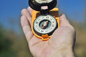 Compass in the palm of your hand. — Stok fotoğraf