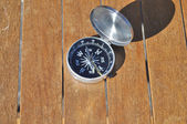 The compass on boards.  — Zdjęcie stockowe