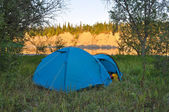 Camping tent on the bank of a river.  — Stock Photo