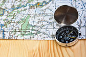 The magnetic compass and topographic map.  — Stockfoto