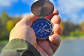 Walking with a compass in his hand.  — Stock Photo
