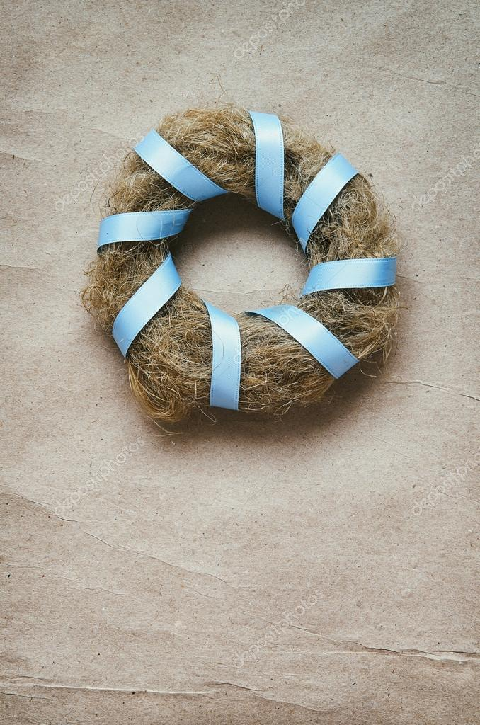 Wreath With Blue Satin Ribbon On Eco Craft Paper Background