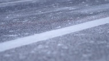 Falling snow on roadway — Stock Video