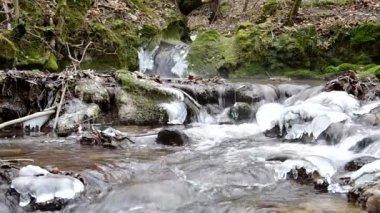 Waterfall in the National Park Slovak Karst, in the village named Haj in winter — Vídeo de stock