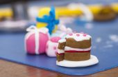 Tiny cake decorations made from fondant — Stock Photo