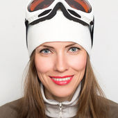 Woman with ski goggles isolated on white — Stock Photo