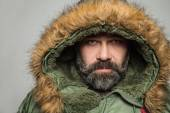Handsome bearded man in parka — Stock Photo