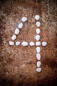 '4' number alphabet made form white stone — Stock Photo