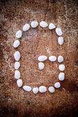'G' alphabet made form white stone — Stock Photo