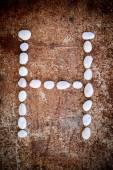 'H' alphabet made form white stone — Stock Photo