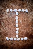 'I' alphabet made form white stone — Stock Photo