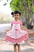 Asian kid show her red dress on nature background — Stock Photo