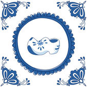 Delft blue tile with a pair of cloggs — Stock Vector