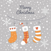 Christmas greeting card with stockings — Stock Vector