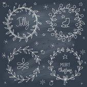 Christmas wreaths set on blackboard — Stock Vector