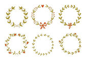 Set of beautiful floral wreaths — Stockvektor