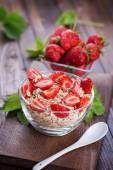 Oat flakes with strawberries — Stock Photo