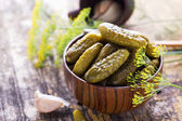 Pickled organic cucumbers — Stock Photo