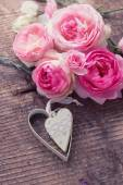 Roses and decorative heart — Stock Photo