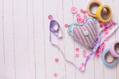 Heart and scrapbooking elements on wooden background — Stock Photo