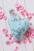 Heart and buttons on wooden background — Stock Photo