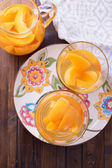 Stewed summer fruits in pitcher — Stock Photo