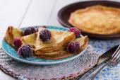 Pancakes or crepes with berries — Stock Photo